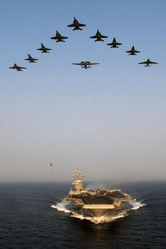 Aircraft from Carrier Air Wing 7 fly over USS Dwight D. Eisenhower. by Official…