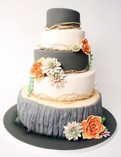 Charcoal grey and ivory nature inspired tree stump wedding cake with pale pink and coral succulents. I like this but perhaps with more browns instead of gray and dark jewel tone flowers instead of coral/pink.