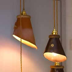Ted Wood's Hang Up Lamp is made from English rawhide leather, with solid brass hardware.
