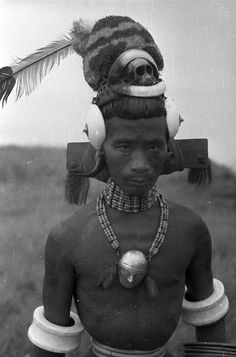 India | To-Ang, the famous Ang of Sheangha; wearing a fine hat, ivory armlets and rattan leg and arm bands. Wakching, Sheangha, Nagaland, Mon District.  1936. | ©SOAS, Nicholas Haimendorf