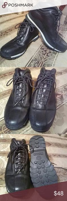 Timberland Men's Boots #85184 The majority of the upper shoe is leather. Black and white masculine shoe laces.  A very handsome and well maintained shoe. Timberland Shoes Boots