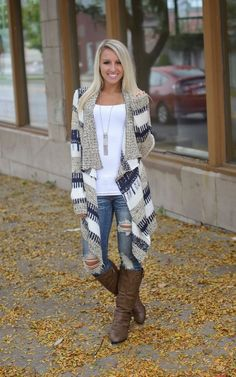 A Long Stylish Cardigan With Leather Boots