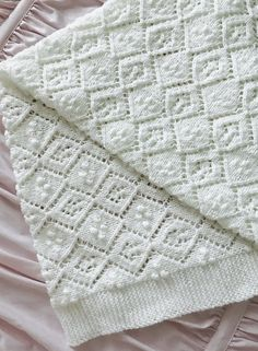 Free Knitting Pattern for Thine Receiving Blanket - Beautiful baby blanket with diamond lace and bobbles in sport weight yarn. 41″ x 42″ Designed by Lynn Christensen
