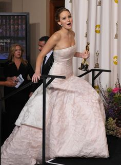 """Jennifer Lawrence On Tripping On Stage:  """"Was the fall on purpose? Absolutely. What do you mean what happened?! Look at my dress. I tried to walk up stairs in this dress. And I think I just stepped on the fabric…and they waxed the stairs.""""    I love her sense of self and humor. I hope Hollywood doesn't ruin that for her."""
