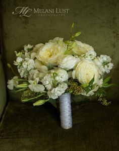 Wedding bouquet in yellow, cream and white tones. ©MelaniLustPhotography