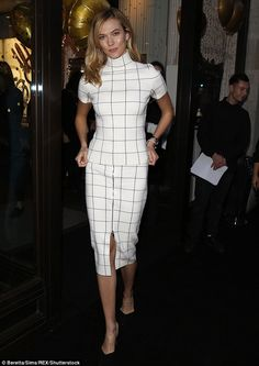 Striking: Karlie Kloss caught the eye in a fitted two-piece ensemble that accentuated her slender physique during a visit to Swarovski in London on Monday evening
