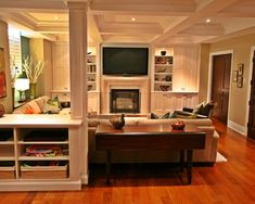 Basement Family Room. good way to enclose support pole