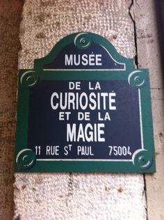 Welcome to one of the coolest and oddest attractions in all of Paris, le Musée de la Magie! This museum is full of amazing artifacts from the history and magic and illusion: antique magicians' props and gadgets, stunning optical illusions, beautiful old posters advertising magic shows, and more, all housed in a spooky old underground chamber that looks like an old wine cellar. The Musée de la Magie is housed in the same building as the Musée des Automates — the automata museum —