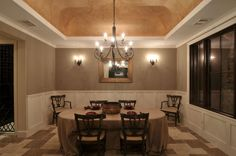 A raised ceiling can add drama to a small space.