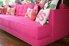 Room Service's Down With Love Sofa ($1,900) features textured pink fabric and chrome nailhead trim. That pop of pink would certainly wake up a room!
