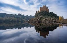 Castle of Almourol stands on a little island that you can reach by boat! [Photo by @julesvernex2] #VisitPortugal #Portugal #travel #castle