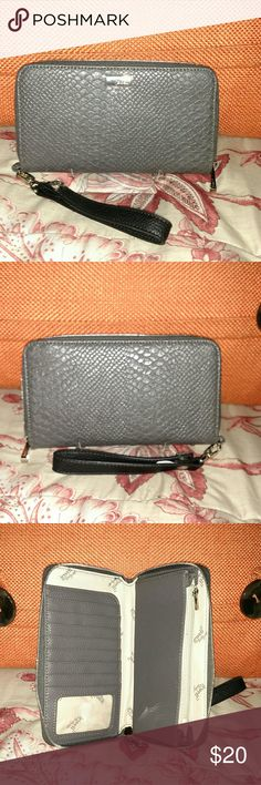 Jewel by Thirty One wristlet wallet New without tags...large nice zip around wallet.  Lots of places to put your items.  Beautiful gray/taupe color with gold accents.  Smoke free home. Thirty One Bags Wallets