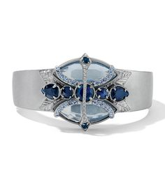 Icara Bracelet: As seen on the Red Carpet Magnetic Closure Hinged Bracelet Light Sapphire & Montana Blue Cut Crystals with Blue Opal & Montana Blue Resin in Matte Silver. Lifetime Guarantee