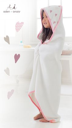 After bath and tub time, our plush terry towel with pink heart muslin hood is just what the snuggle doctor ordered.