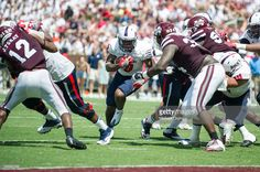 Running back Tyreis Thomas #9 of the South Alabama Jaguars looks to run the ball through traffic during their game against the Mississippi State Bulldogs at Davis Wade Stadium on September 3, 2016 in Starkville, Mississippi. The South Alabama Jaguars defeated the Mississippi State Bulldogs 21-20.
