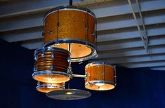 drum chandelier - These chandelier drums are an unlikely mash-up of two very different products.   Created as a way to pay tribute to the restaurant that occupied th...