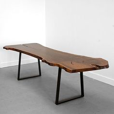 Trapped Base Table by Uhuru:  This gorgeous dining table adds a big old rustic slab of wood (sustainably harvested, then locally milled in Brooklyn) with modern trapezoid table legs. The possibilities for dining chairs and benches to add to it are practically endless, whether you by a matching set or mix and match.