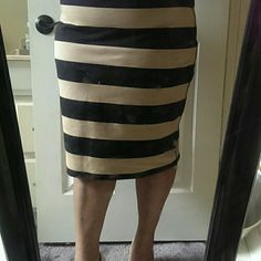 "Cute Tan Bandage Skirt Black & tan stretch bandage skirt. 87% Cotton 13% Spandex. 24"" L. BOOTS COMPLETE THE OUTFIT. Check Closet.  ***Actual size XL but runs big... fits XXL Skirts"