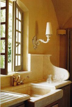 Blahnaid Behan is a British interior designer who restored this home to its former charm. Stone sink in Provence