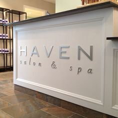 Our new brushed metal logo looks right at home on our front desk... Big thanks to Summit Signs:)