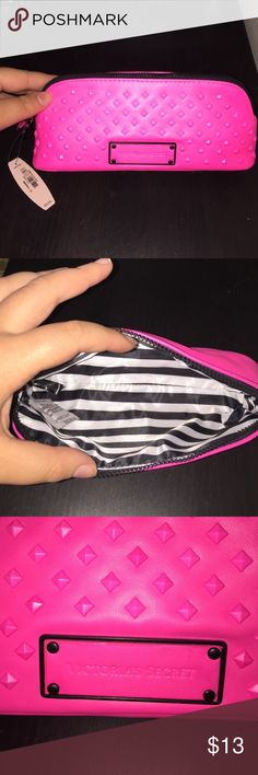 Victoria's Secret makeup bag Victoria's Secret make up bag. Brand New never used. Hot pink, black and white stripe inside. There is a small mark on the back that I point at in the picture. Victoria's Secret Bags Cosmetic Bags & Cases
