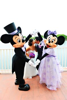 Mickey and Minnie Mouse congratulate the newlyweds during their fairy tale wedding