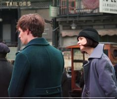 Side view of the black(green tinted) bell hat- felt ribbon.  light grey long felt, wool or wool blended trench coat- very soft to the touch.  Porpentina Tina cosplay costume, fantastic beasts, porpentina Goldstein-