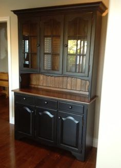 Classic Furniture Restoration updated this traditional oak hutch by painting the  outside and applying a contrasting stain inside.