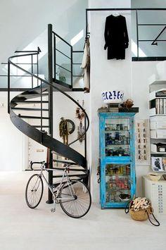 spiral staircase in loft  bike and blue shelf