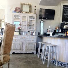 Cute Cafe with distressed furniture and simple stools