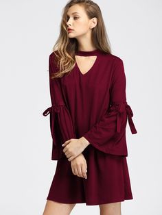 Dresses by BORNTOWEAR. V Cut Choker Neck Fluted Sleeve Tie Detail Dress