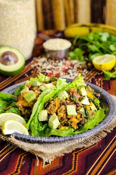 Fiesta Lettuce Wraps- quinoa, black beans, bell pepper, plantains, cilantro tomato, etc.  Sounds tasty!