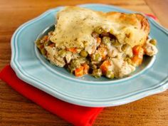 Magic Chicken Ranch Casserole - This easy popover casserole does amazing things in the oven! You won't believe me until you see it puff up beautifully before your eyes. Then you'll know how it got its name!  Get the easy casserole recipe with ranch right here...