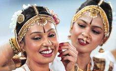 two foreign women in indian traditional jewellery