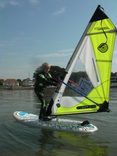 A static 180 degree turn.  Kids learn how to windsurf really fast at the Poole Windsurfing School, with the latest light weight junior sails & special narrow grip booms and masts.  A perfect way to get them into a new sport.  #poolewindsurfing #windsurfinglessons #pooleharbour