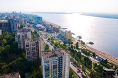 View of Samara, Russia including the Volga river and its beach, some apartment buildings and parks.