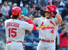 Yadier Molina Photos - Yadier Molina #4 of the St. Louis Cardinals is congratulated by Randal Grichuk #15 after scoring a ninth inning run against the Atlanta Braves at Turner Field on April 10, 2016 in Atlanta, Georgia. - St Louis Cardinals v Atlanta Braves