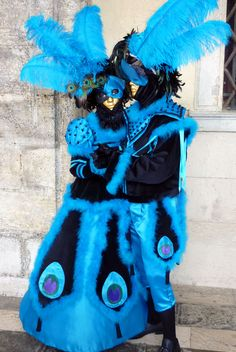 https://flic.kr/p/7H35wk | Two charactors in peacock colors (P1000507a) | I took this photo while wandering aimlessly around Venice during the 2010 Carnevale. It was an incredible experience.  I had the chance to shoot with a large number of people in gorgeous costumes and masks -  I'm already looking forward to going back there again.  I took this photo under the archways in the Doges Palace in Venice on Tuesday, 9 Feb 2010.  This was my first usage of a small point and shoot camera - a ...