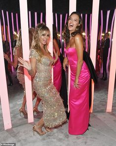 Party pals: Heidi Klum and Alessandra Ambrosio were putting on a playful display as they p...
