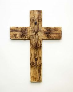 This is a beautiful Rustic White Wooden Cross that can bring a bit of shabby chic comfort to your western home. It is accented with a filigree metal shape and It is hand made. It hangs on the wall and