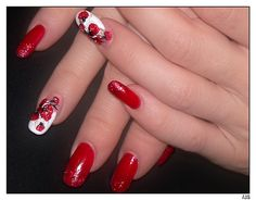 Art Nail in red decoration of a finger