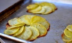 Pommes Maxim by ashleybrouwer as adapted from nytimes: Overlapping circles of thinly-sliced potatoes bake up golden and crispy. Add a sprig of rosemary to the middle of each spiral, serve with a dollop of aioli on top I Love Food, Good Food, Yummy Food, Vegan Dishes, Tasty Dishes, Side Dishes, Chef Recipes, Snack Recipes, Dinner Recipes