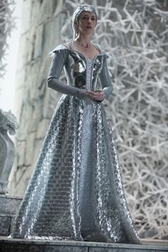 Emily Blunt stars in 'The Huntsman: Winter's War' as the ice queen Freya. In this photo, Blunt wears a large leather jacket that has been painted to look silver.