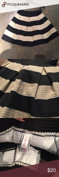 Skirt Skirt is like new (work once) from the Xhiliartion line at target. Is made of a stretchy fabric with metallic gold detail. Skirt is voluminous, comfortable to wear, and great for parties/NYE! Xhilaration Skirts