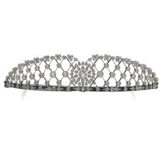 FROM THE COLLECTION OF MRS. MARY PHOEBE DANGAR: DIAMOND TIARA, CIRCA 1904. Of lattice work design, decorated with circular- and single-cut diamonds, the central diamond swing-set.