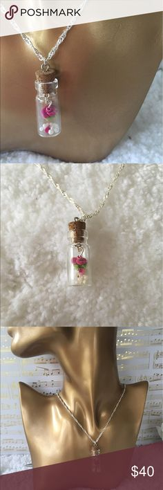Clay miniature rose in a bottle. Handmade clay miniature rose in a glass bottle. Includes gift bag and boutique tag. Jewelry Necklaces