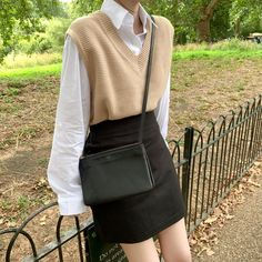 Beautiful V Neck Knitted Vest. Very soft and comfy! You may think it is only for mid-aged people, but you are wrong! Vests and sweaters have been growing in the number of purchases across many young women based brands. 🍏 Price: $27.52  #sweaters #women #shop Adrette Outfits, Korean Outfits, Casual Outfits, Fashion Outfits, Preppy School Outfits, Korean Winter Outfits, Vest Outfits For Women, Korean Ootd, School Uniform Outfits