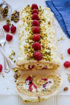 A Raspberry Pistachio White Chocolate Roulade is the perfect easy, forgiving showstopper dessert to make at any time of year, ready in under an hour! Baking Recipes, Cake Recipes, Dessert Recipes, Winter Torte, Roulade Recipe, Chocolate Roulade, Bon Dessert, Desserts To Make, Savoury Cake