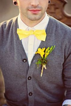 groom in gray cashmere cardigan with bright yellow bow tie and boutonniere