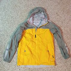 Columbia rain jacket Excellent condition rain jacket with hood! I believe is in a kids size Columbia Jackets & Coats